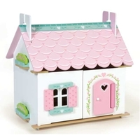 Small wooden dolls house with furniture