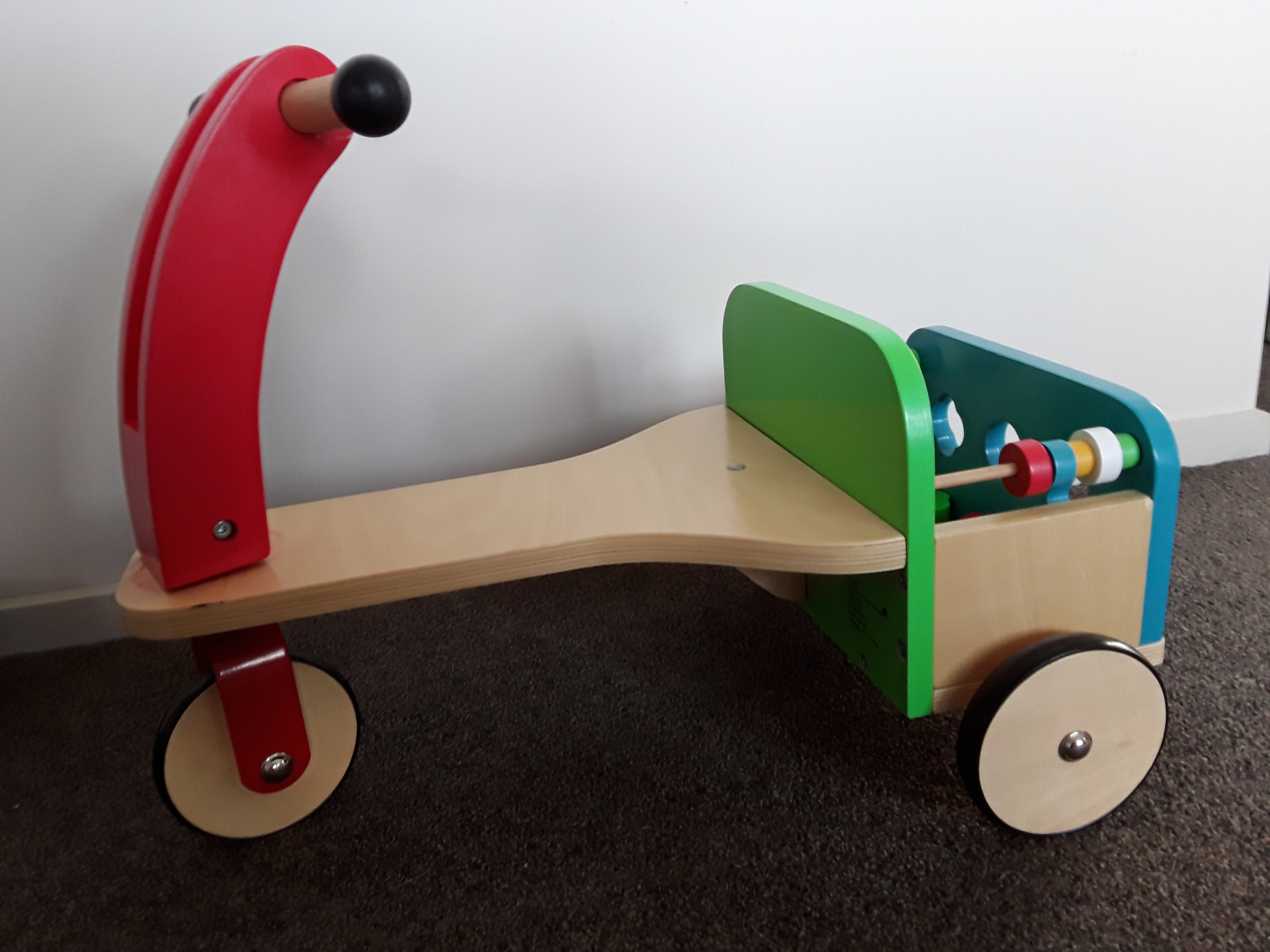 Tricycle with shape sorter photo
